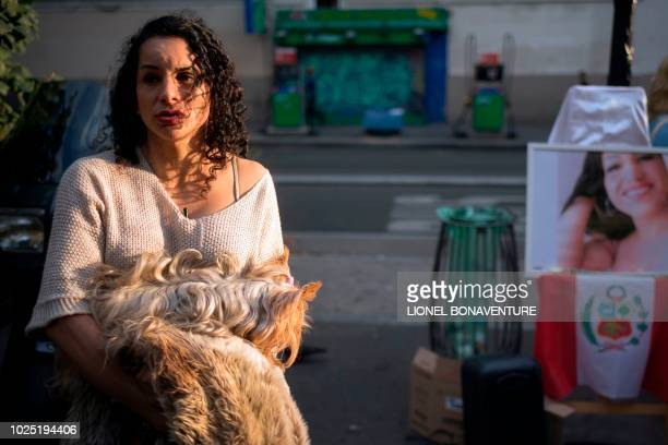 Sandra a 38yearold transsexual sex worker from Peru answers journalists' questions as people gather to pay tribute to Vanesa Campos a 36 yearold...