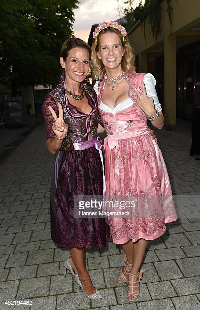Sandra Abt and Monica Ivancan attend the Sixt ladies dirndl dinner on July 15 2014 in Munich Germany