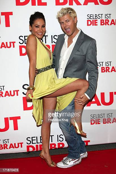 Sandra Ahrabian With Unknown Man In The Name Of The Germany premiere movie 'Even If The Bride' In Mathäser movie palace in Munich