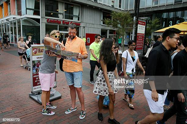 Sandra and Christoph Bayer of Hamburg Germany study a map in Forbes Plaza at Harvard Square in Cambridge MA on Aug 25 2015 The couple are recently...