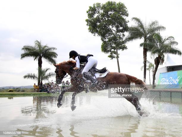 Sandra Auffarth of Germany on horse Opgun Louvo in action during the Eventing Cross Country of the Equestrian events at the Rio 2016 Olympic Games at...