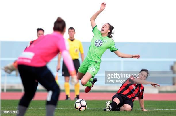 Sandra Bernal of SC Huelva makes fault for penalty over Tessa Wullaert of Wolfsburg under watch of Sara Serrat of SC Huelva during the Women's...