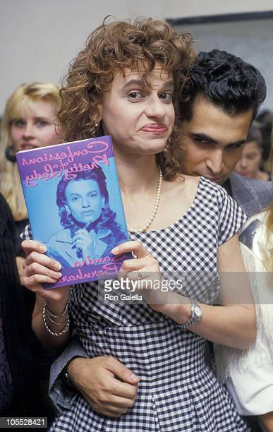 Sandra Bernhard and John Malatesta during Sandra Bernhard Confessions of a Pretty Lady Book Party August 25 1988 at Club MK in New York City New York...