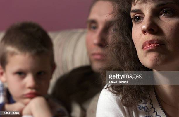 BLAD33/28/2001 Sandra Blad and her husband Gary and middle child Corey listen to a question during an interview Blad mother of three little children...