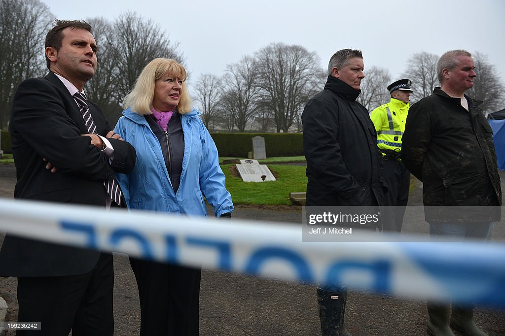 Sandra Brown (2nd L) reacts following the conformation that a grave at Old Monkton cemetery does not contain the body of missing schoolgirl Mora Anderson on January 10, 2013 in Coatbridge,Scotland. Mrs Brown believes that her late father Alexander Gartshore, a former bus driver and convicted rapist, had some involvement in the abduction and murder of schoolgirl Moira Anderson. The 11-year-old school girl went missing in 1957.