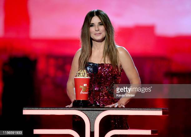 Sandra Bullock accepts the Most Frightened Performance award for 'Bird Box' onstage during the 2019 MTV Movie and TV Awards at Barker Hangar on June...