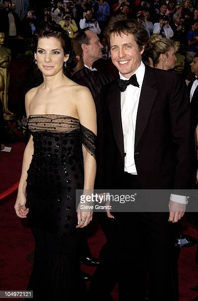 Sandra Bullock and Hugh Grant during The 74th Annual Academy Awards Arrivals at Kodak Theater in Hollywood California United States
