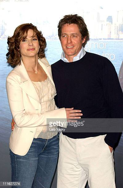 """Sandra Bullock and Hugh Grant during """"Two Weeks Notice"""" Photocall - Madrid at Villa Magna Hotel in Madrid, Spain."""