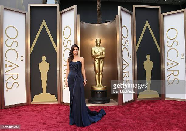 Sandra Bullock arrives at the 86th Annual Academy Awards at Hollywood Highland Center on March 2 2014 in Los Angeles California