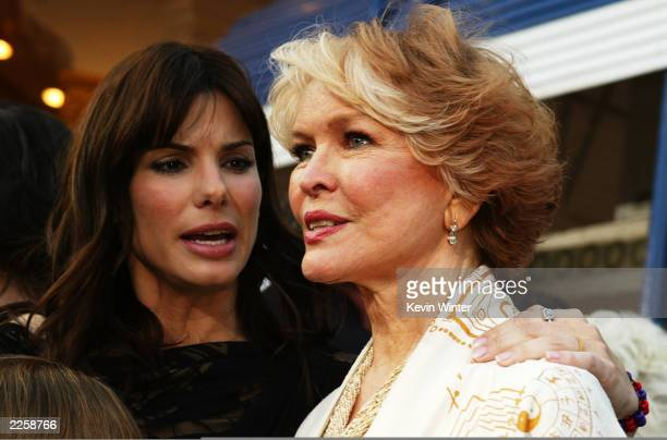 Sandra Bullock chats with Ellen Burstyn as they arrive for the premiere of Divine Secrets Of The Ya-Ya Sisterhood at the Mann Village Theater in Los...