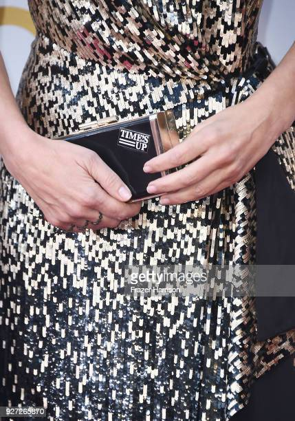 Sandra Bullock fashion purse and Time's Up pin details attends the 90th Annual Academy Awards at Hollywood Highland Center on March 4 2018 in...
