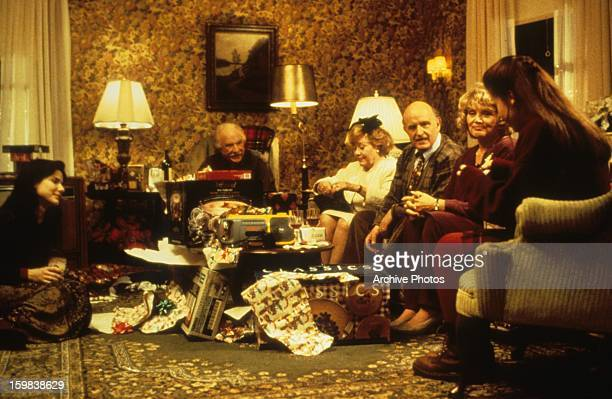 Sandra Bullock Glynis Johns and others sit around a room in a scene from the film 'While You Were Sleeping' 1995