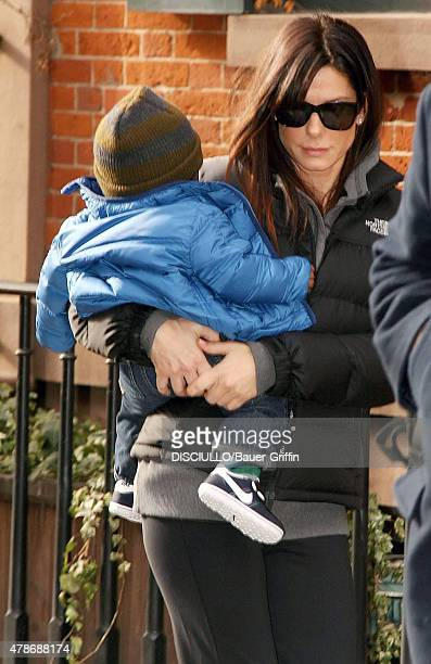 Sandra Bullock is seen carrying her son, Louis Bardo Bullock on January 20, 2011 in New York City.