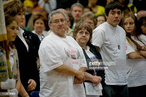 Sandra Cantu's grandparents Joe and Delores Chavez, brother Tommy Fortin and sister Simone Mokol watch as the color guard girl scouts arrive during a...
