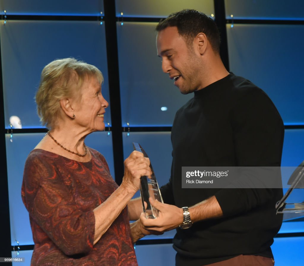 Sandra Chapin presents an award to owner of School Boy Records and RBMG, Scooter Braun and take photos before the Music Biz 2018 Awards Luncheon for the Music Business Association on May 17, 2018 in Nashville, Tennessee.