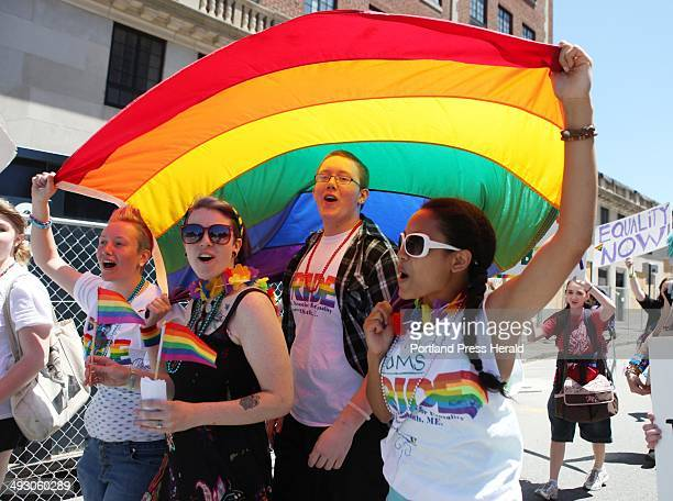 Sandra Curry left to right Cassia Tirrell Nathaniel Curry and Alizha Gagnon march Saturday June 15 2013 during the annual Pride Parade in Portland...