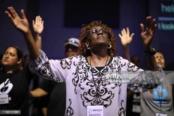 Sandra Deadwyler joins fellow worshipers during a prayer vigil at Bridge Church the day after a mass shooting June 01, 2019 in Virginia Beach,...