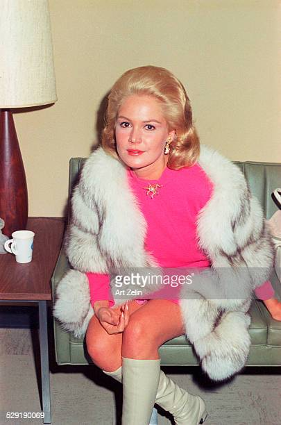 Sandra Dee seated wearing a gray and white fur coat circa 1970 New York