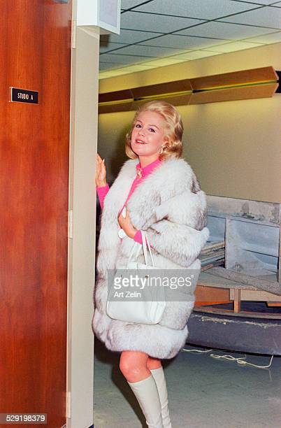 Sandra Dee standing posing for the photographer wearing a gray and white fur circa 1970 New York
