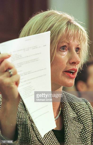 Sandra England Senior Vice President of McAfee a Network Associates company holds up the source code of the 'Love Bug' virus May 10 2000 before the...