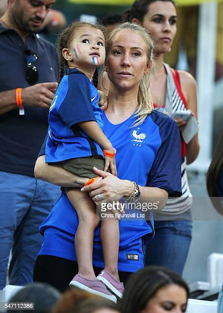 Sandra Evra wife of Patrice Evra of France holds her daughter Maona during the UEFA Euro 2016 Semi Final match between Germany and France at Stade...