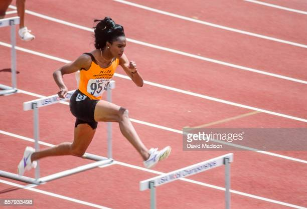 Sandra Farmer Patrick of the USA competes in the 400 meter hurdles event during the 1991 US Track and Field Championships held in June 1991 at...