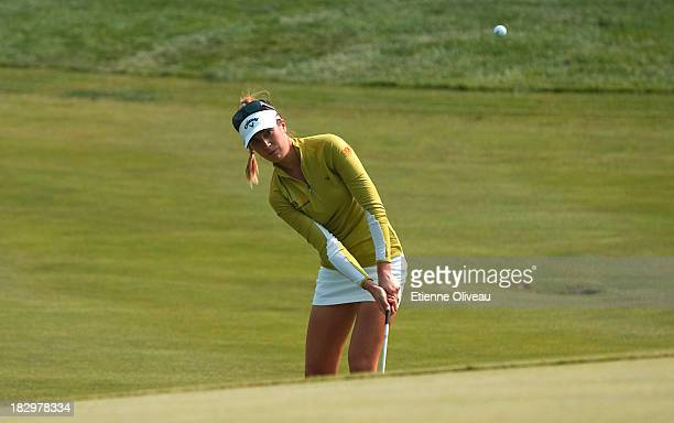 Sandra Gal of Germany chips onto a green during the first round of the Reignwood LPGA Classic at Pine Valley Golf Club on October 3 2013 in Beijing...