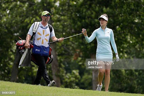 Sandra Gal of Germany hands a club to her caddie after hitting her second shot on the 18th hole during the second round of the Walmart NW Arkansas...