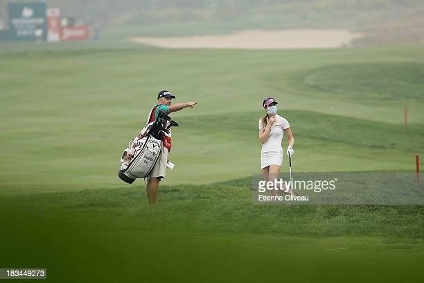 Sandra Gal of Germany listens to her caddie during the final round of the Reignwood LPGA Classic at Pine Valley Golf Club on October 6 2013 in...