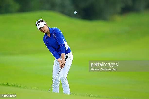 Sandra Gal of the European Team chips the ball at the first green during the Sundays single matches in the 2015 Solheim Cup at St LeonRot Golf Club...