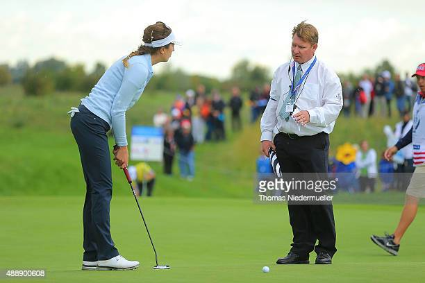 Sandra Gal of the European Team talks to the referee during the afternoon fourball matches on day one of the Solheim Cup 2015 at St LeonRot Golf Club...