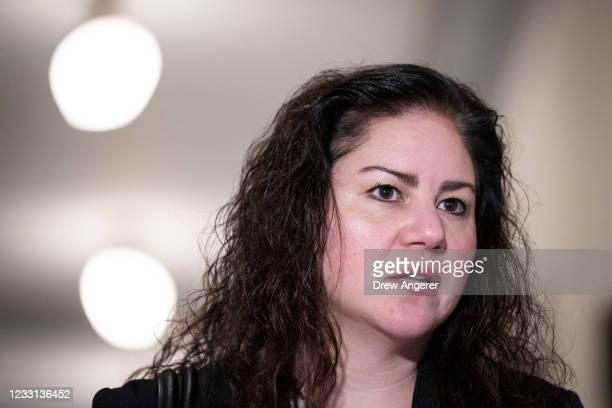 Sandra Garza, of the late Capitol Police officer Brian Sicknick, speaks to the press as they leave a meeting with Sen. Mitt Romney to urge for a...