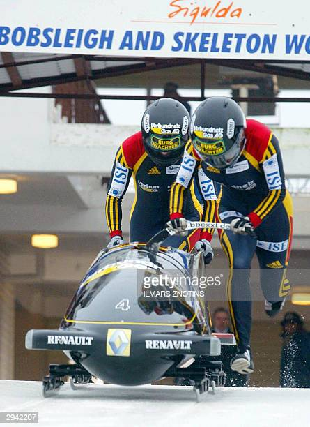 Sandra Germain and Cathleen Martini of Germany run at the start of a women's World Cup Bobsleigh event 07 February 2004 in Sigulda Germain and...