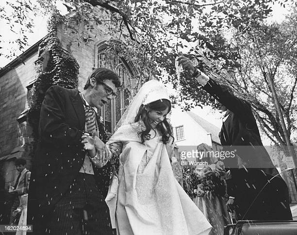 AUG 18 1969 Sandra Guiry and Wesley Winfield Hoyt Wed in Saturday Rites Gregory Hoyt right showers rice on newlyweds Mr and St Martin's Chapel of St...