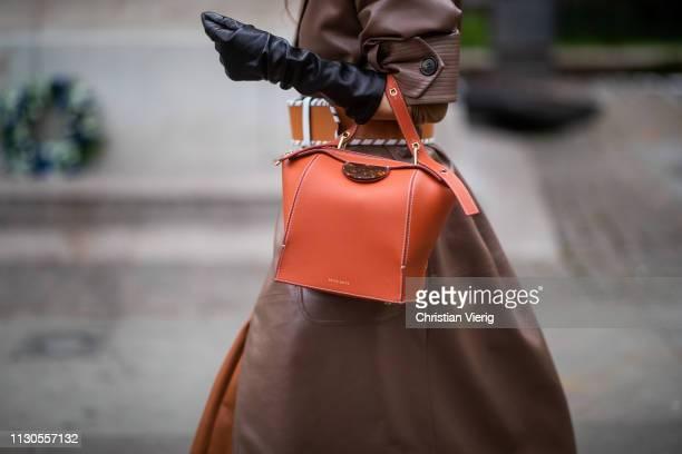 Sandra Hagelstam is seen wearing brown coat orange bag Danse Lente black gloves outside Erdem during London Fashion Week February 2019 on February 18...