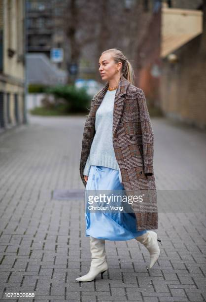 Sandra Hagelstam is seen wearing light blue knit blue silk dress boots brown checked wool coat outside Samsoe Samsoe Autumn 2019 Resee on December 13...