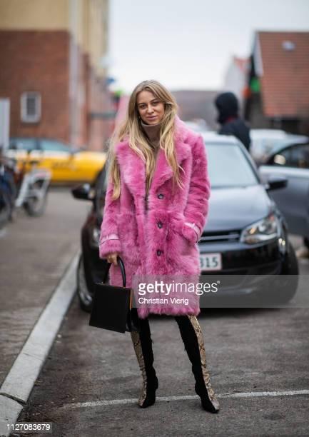 Sandra Hagelstam is seen wearing pink faux fur coat two tone Celine boots with snake print outside Baum und Pferdgarten during the Copenhagen Fashion...