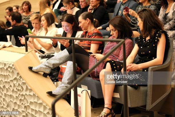Sandra Hueller Johanna Wokalek Hannah Herzsprung Christiane Paul Nicolette Krebitz and Lea van Acken with mobile phones during the Chanel...