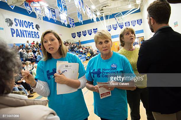 Sandra Ketner and Sonia Kerin supporters of Democratic presidential candidate Hillary Clinton and former Nevada State Treasurer Kate Marshall try to...