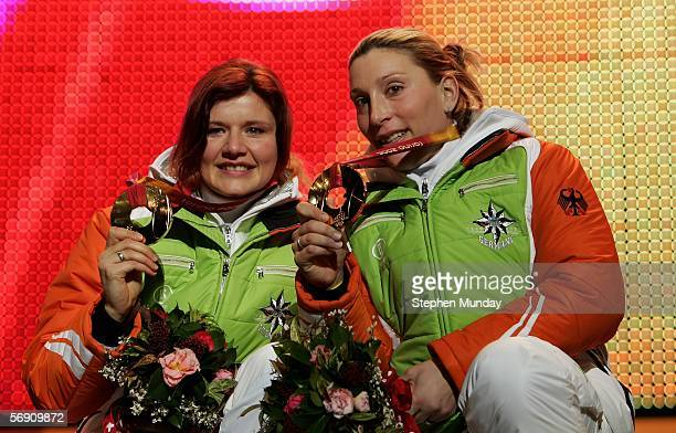 Sandra Kiriasis and Anja Schneiderheinze of Germany receive the Gold medal in the Two Woman Bobsleigh at the Medals Plaza on Day 11 of the 2006 Turin...