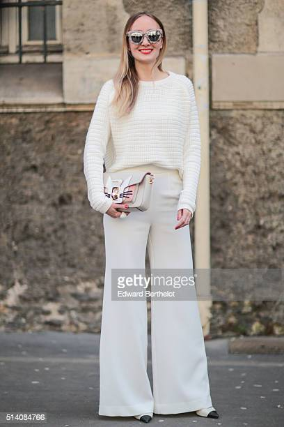 Sandra Kleine Staarman is wearing a Karl Lagerfeld bag and a white total look before the John Galliano show during Paris Fashion Week Womenswear Fall...