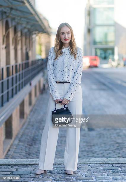 Sandra Kleine Staarman wearing white wide leg Marc Cain pants and Marc Cain blouse with bow tie black Marc Cain bag during the MercedesBenz Fashion...