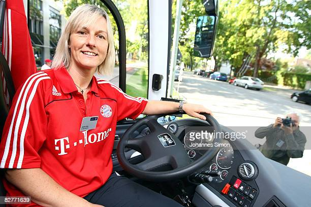 Sandra Koenig bus driver of Bayern Muenchen poses at the steering wheel of the new FC Bayern Muenchen team bus on September 11 2008 in Munich Germany