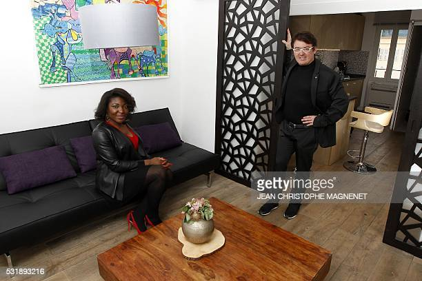 Sandra Kossingou and Julien Tabore associates of the company 'Canne's bnb' pose in a rental flat on May 2 in the city of Cannes southeastern France...