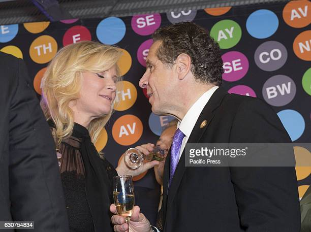 Sandra Lee and Governor Andrew Cuomo ring New Year during 2nd avenue subway celebration at 72nd street station in Manhattan