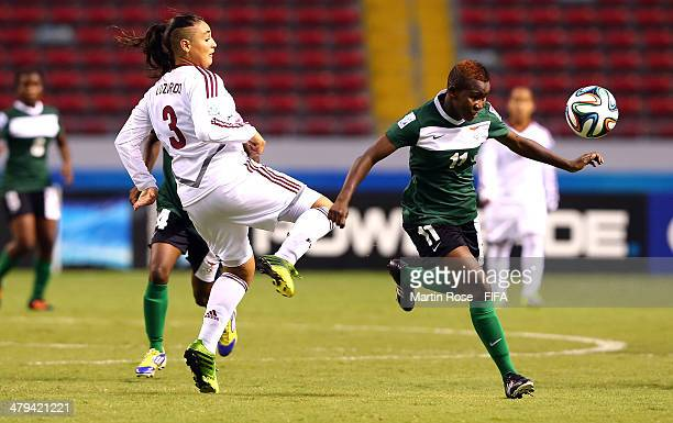 Sandra Luzardo of Venezuela and Gabriela Garcia of Zambia battle for the ball during the FIFA U17 Women's World Cup 2014 group A match between...