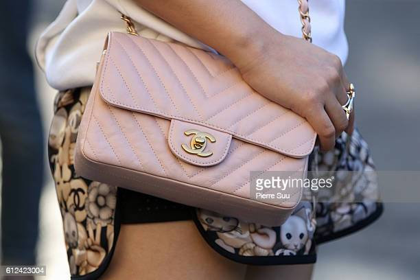 Sandra Ma handbag detail arrives at the Chanel show as part of the Paris Fashion Week Womenswear Spring/Summer 2017 on October 4 2016 in Paris France