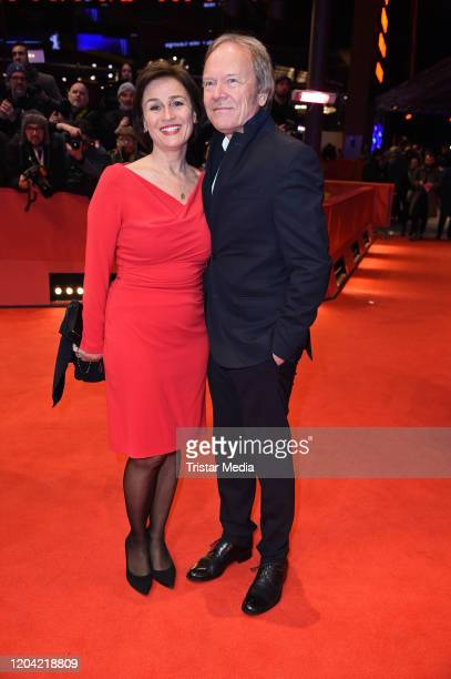 Sandra Maischberger and Jan Kerhart arrive for the closing ceremony of the 70th Berlinale International Film Festival Berlin at Berlinale Palace on...