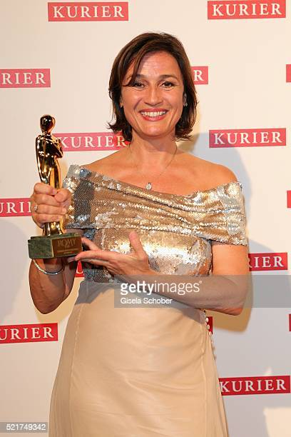 Sandra Maischberger poses with her award during the 27th ROMY Award 2015 at Hofburg Vienna on April 16 2016 in Vienna Austria