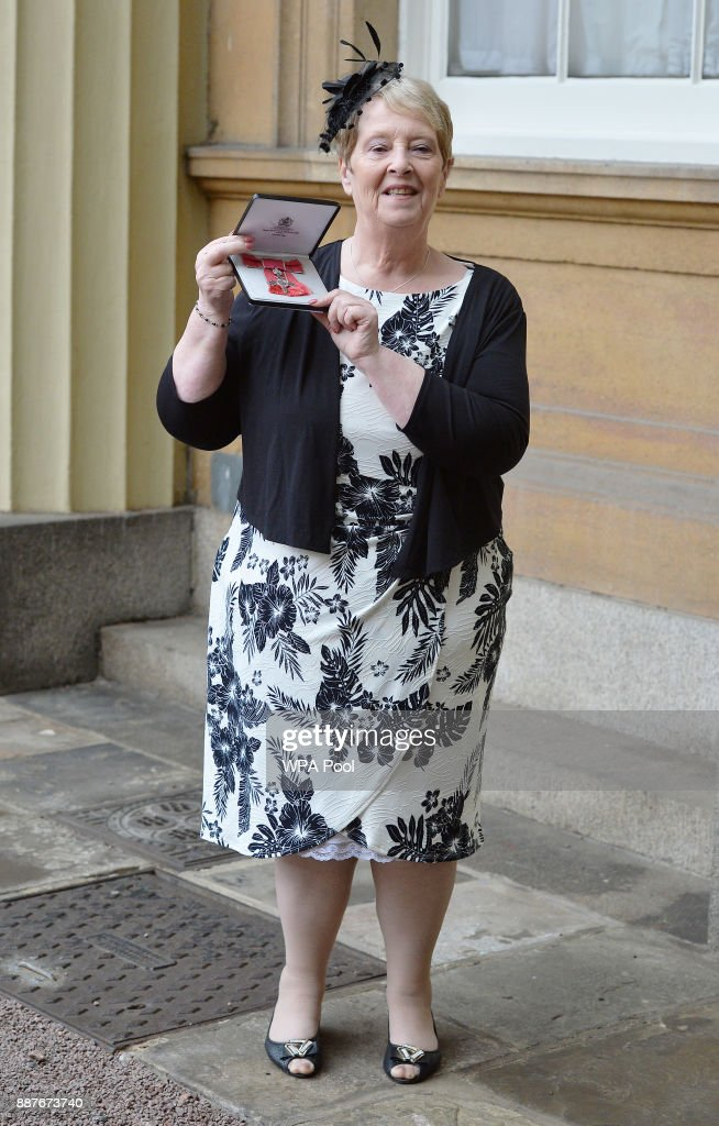 Sandra Major poses with her Member of the British Empire (MBE) medal that was presented to him by the Prince of Wales during an Investiture ceremony on December 7, 2017 at Buckingham Palace, London.
